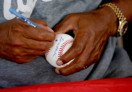 Lou Whitaker signs a baseball for a fan at Seventh Inning Stretch on Main Street in downtown Cooperstown, N.Y. on Saturday, July 28, 2018. Whitaker is in town for an autograph session and to support his Detroit Tigers teammates Alan Trammell and Jack Morris.