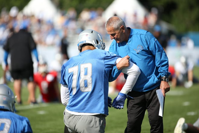 Detroit Lions Special Teams Coordinator Joe Marciano gives directions to Defensive Lineman Jeremiah Valoaga, during the Detroit Lions training camp at their practice facility in Allen Park on Sat. July 28, 2018.