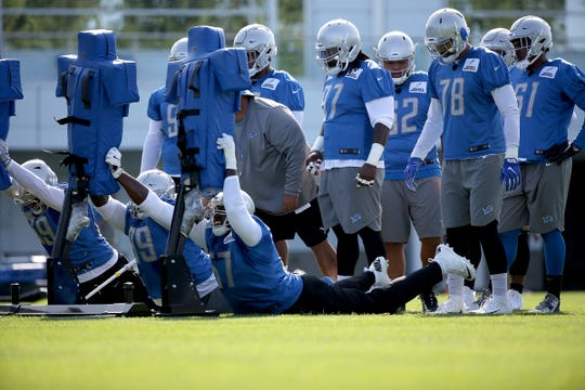 The defensive line runs a drill, during the Detroit Lions training camp at their practice facility in Allen Park on Sat. July 28, 2018.