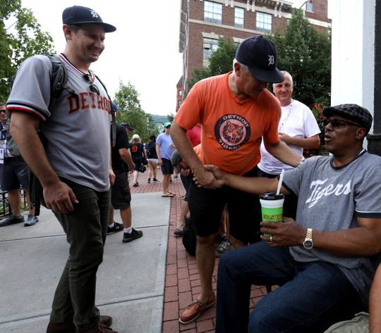 For most of the afternoon former Detroit Tigers star Lou Whitaker sat on a park bench on the sidewalk of Main Street in downtown Cooperstown, N.Y. on Saturday, July 28, 2018 shaking hands and taking pictures with Tiger fans.
