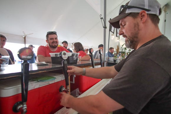 Mark Rowe, of Watervliet's Arclight Brewing, pours one of their lambic ales at the Summer Beer Festival in Ypsilanti.