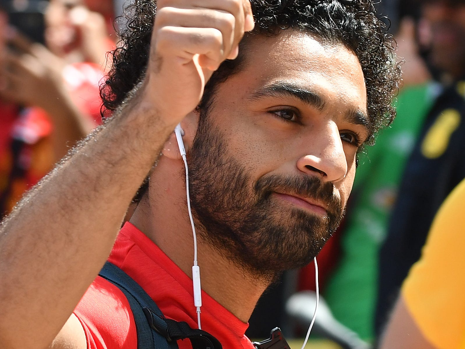 Liverpool midfielder Mohamed Salah gives the thumbs up as he arrives to Michigan Stadium for the game against Manchester.
