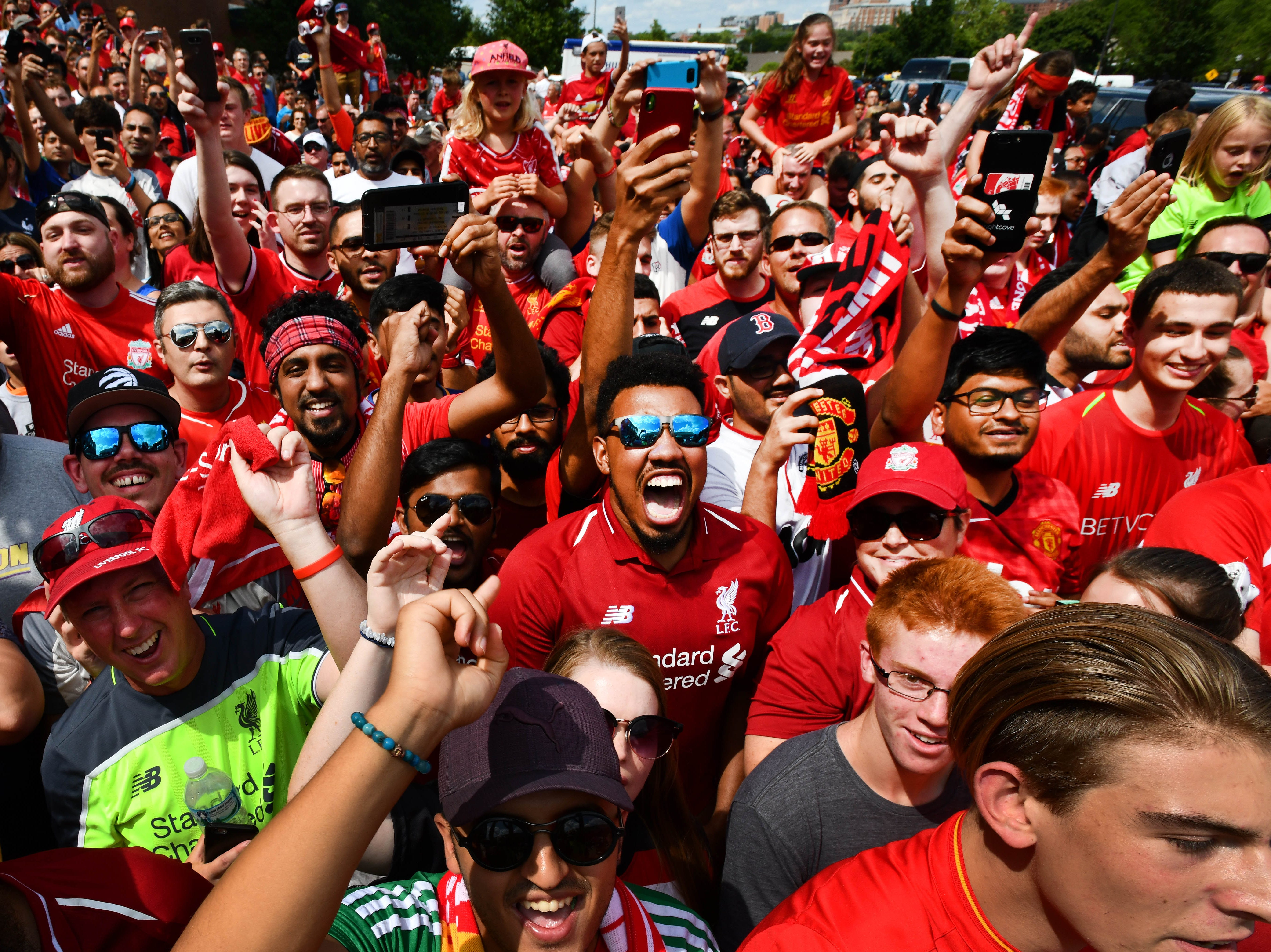 Crowds react as Manchester United and Liverpool buses arrive for the International Champions Cup game  at Michigan Stadium.