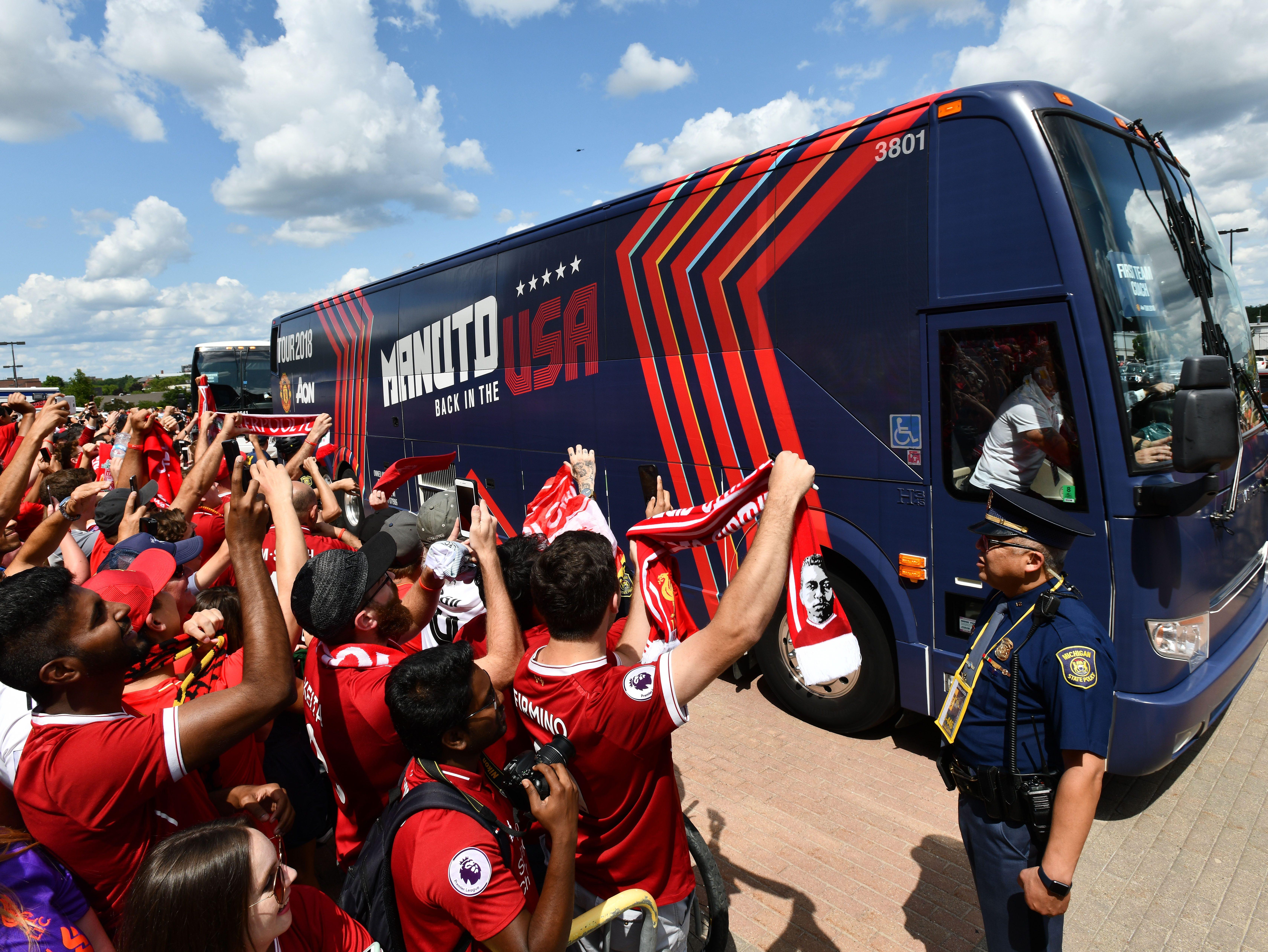 Manchester United bus arrives.