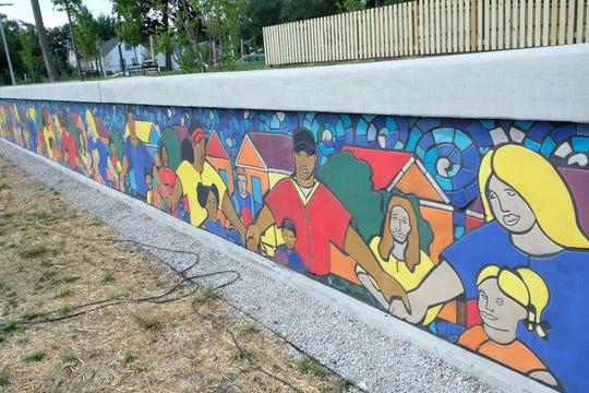 Mural by award-winning artist Hubert Massey stretches across the parks multi-use sports area.