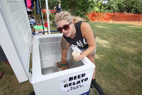 Jessica Sanchez, of Sherwood Brewing, serves up a honey porter beer gelato at the Michigan Brewers Guild's Summer Beer Festival.