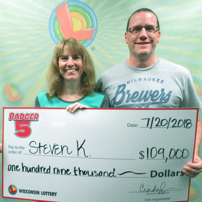 Steven Kraus, at right, won $109,000 from the Wisconsin Lottery in June.