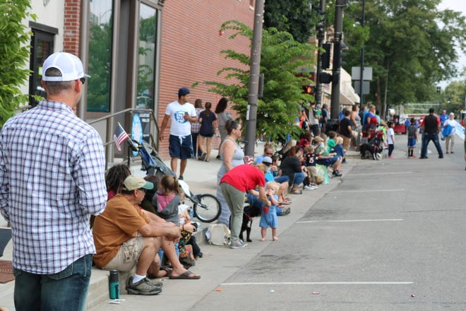 A crowd lines the street of downtown Loveland for the Members of the Larimer County Fair Parade in Loveland on Saturday, July 28, 2018.