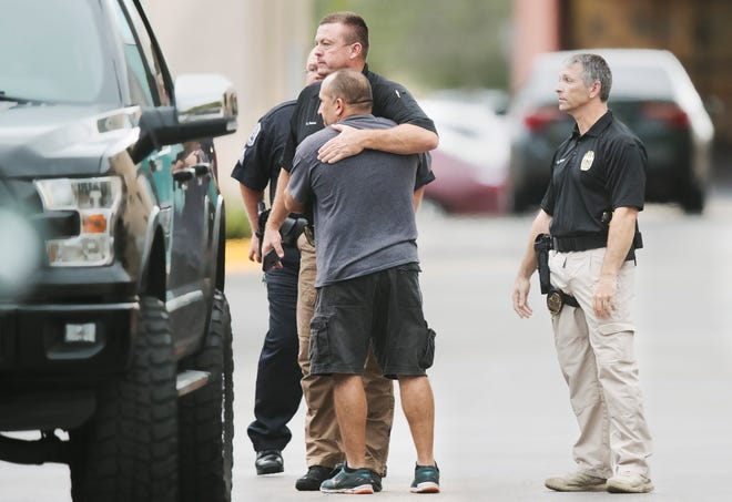 Fort Myers Police officers comfort one another Saturday outside Lee Memorial Hospital after learning fellow officer Adam Jobbers-Miller died. Jobbers-Miller was shot a week ago in the line of duty.