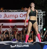 Sandi Morris reacts after clearing 4.95m/16'3 during the Liberty Bridge Jump-Off on South Main St. in downtown Greenville Friday, July 27, 2018.
