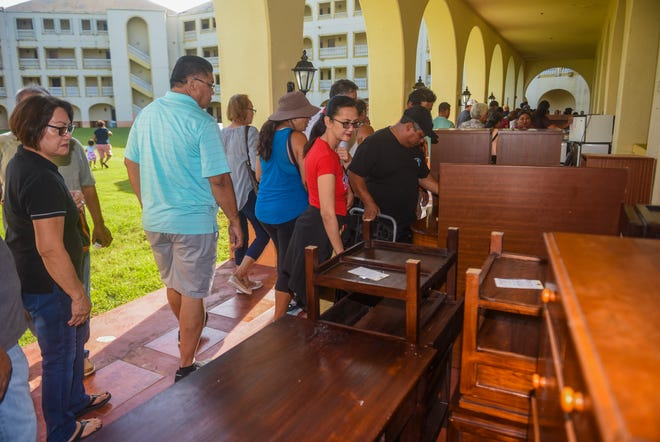 Bargain hunters look over furnishings displayed during a cash and carry sale held by the Archdiocese of Agana at the former Accion Hotel in Yona on Saturday, July 28, 2018. The Archdiocese hosted the sale to clear the contents from the property in efforts to prepare the real estate to be sold, said Deacon Leonard Stohr of the Our Lady of Lourdes Catholic Church in Yigo.