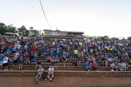 The empty seats mean fans know they'll get pelted with dirt if they sit too close during 2018 USAC AMSOIL National Sprint Car season, at Bloomington Speedway, Friday, July 27, 2018.