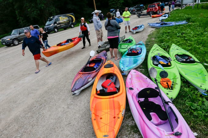 People line up their kayaks at the Henry Schuette launch before a moonlight paddle on the Manitowoc River Friday, July 27, 2018, in Manitowoc, Wis. Josh Clark/USA TODAY NETWORK-Wisconsin