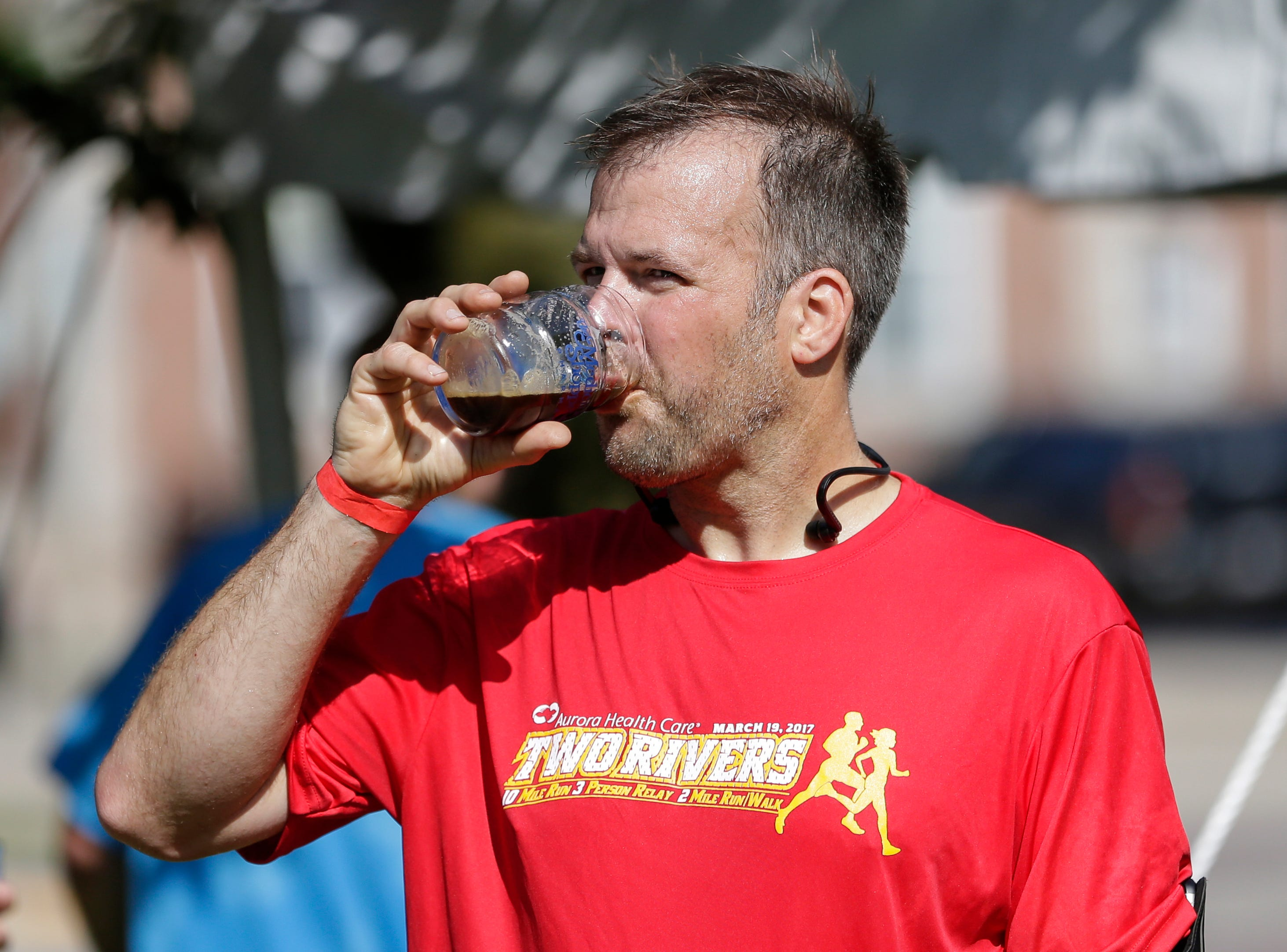 Jeff Schmid takes a sip of beer after running the 5k Brew Dash Saturday, July 28, 2018, in Two Rivers, Wis. Josh Clark/USA TODAY NETWORK-Wisconsin