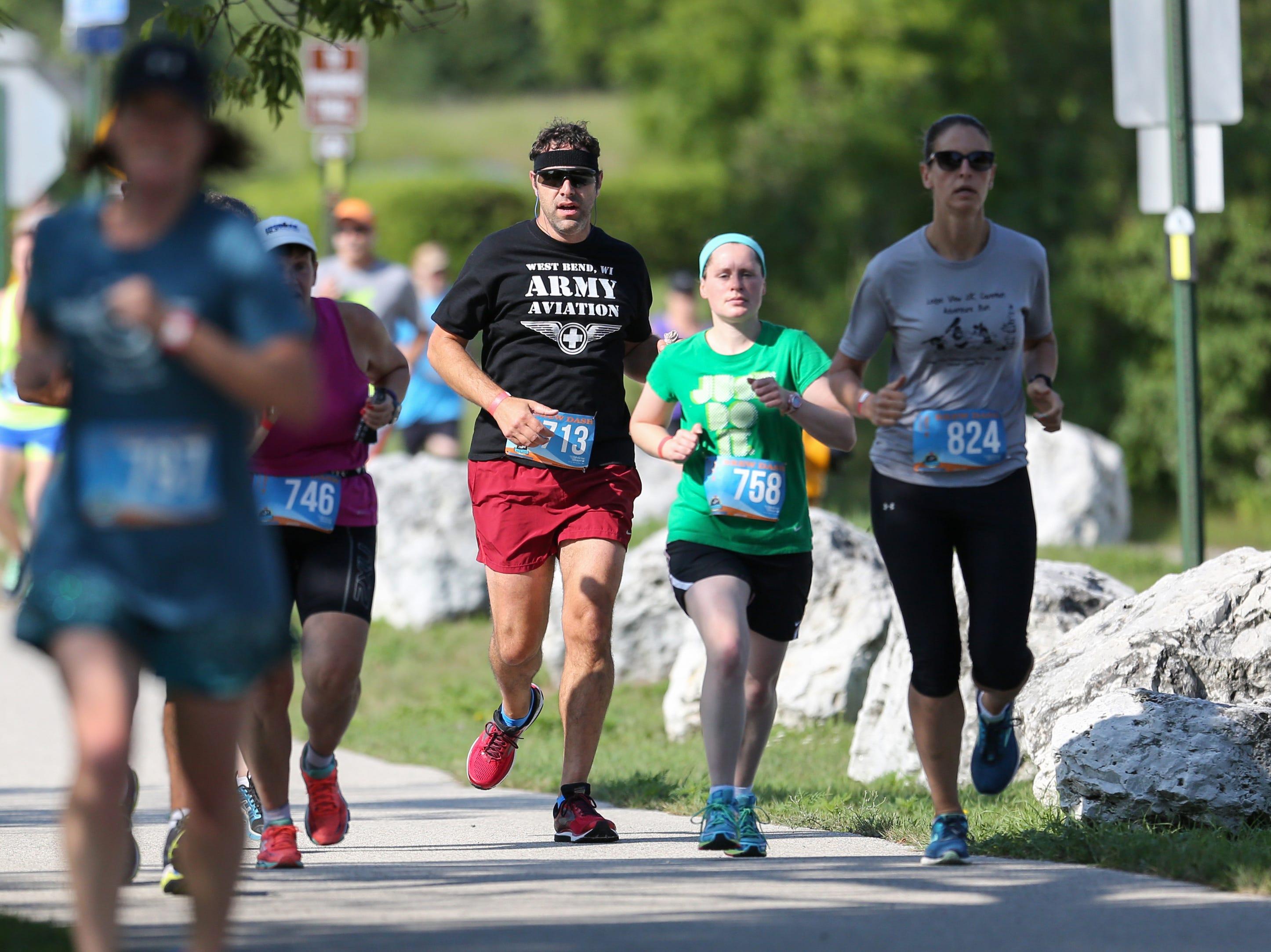 Runners cruise along Lake Michigan on Neshota Beach during the Brew Dash Saturday, July 28, 2018, in Two Rivers, Wis. Josh Clark/USA TODAY NETWORK-Wisconsin