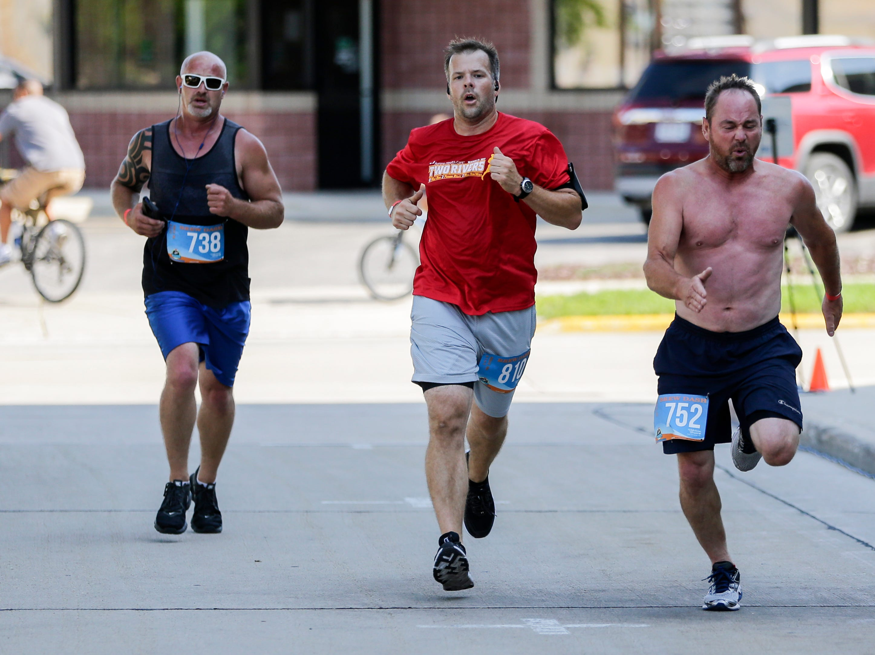 Runners strain to finish the last few feet of the Brew Dash Saturday, July 28, 2018, in Two Rivers, Wis. Josh Clark/USA TODAY NETWORK-Wisconsin
