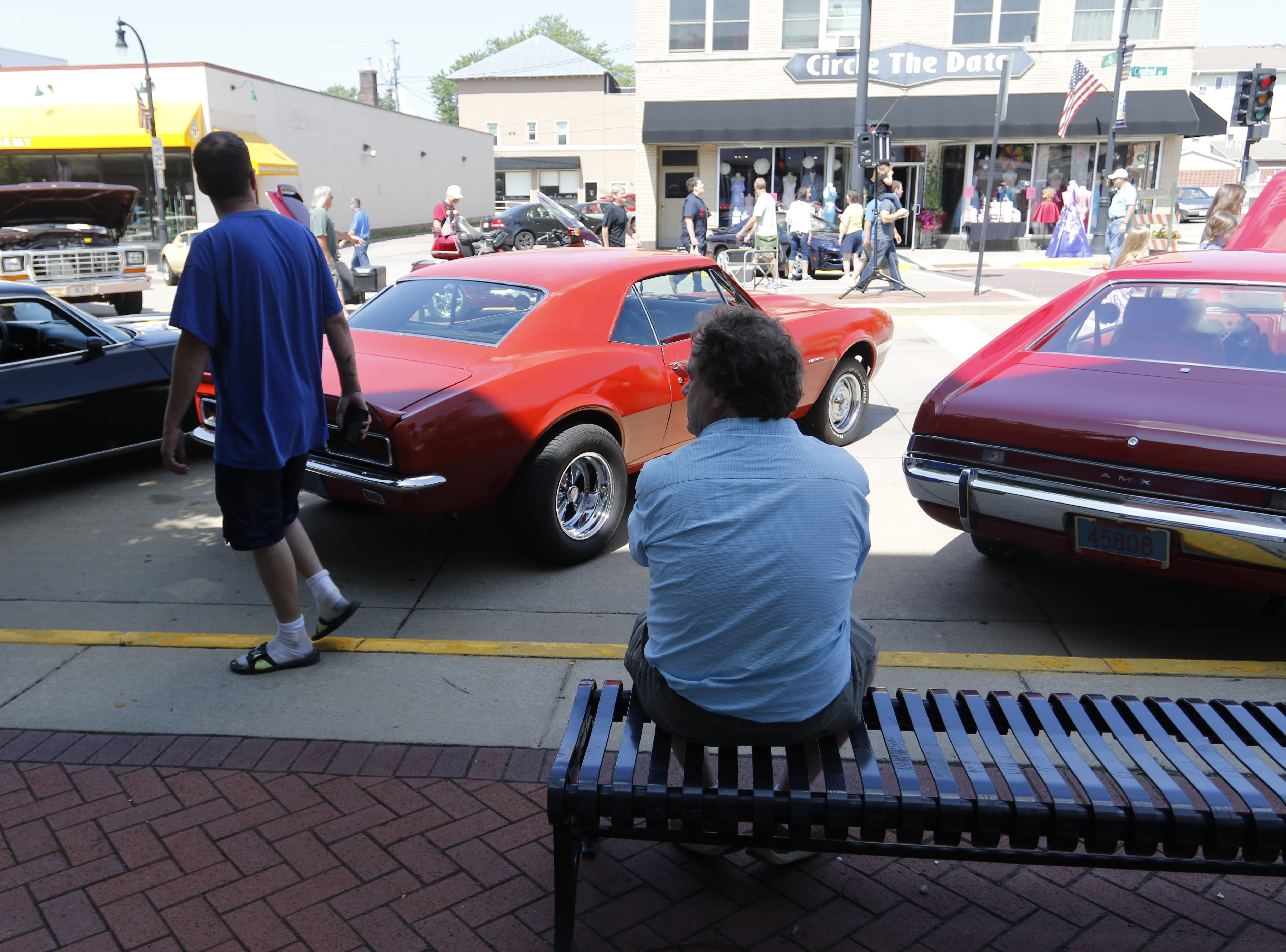 Tom Prechel from Media, Penn. looks at the cars on Central Avenue during the car show at Hub City Days in downtown Marshfield Saturday, July 28, 2018.