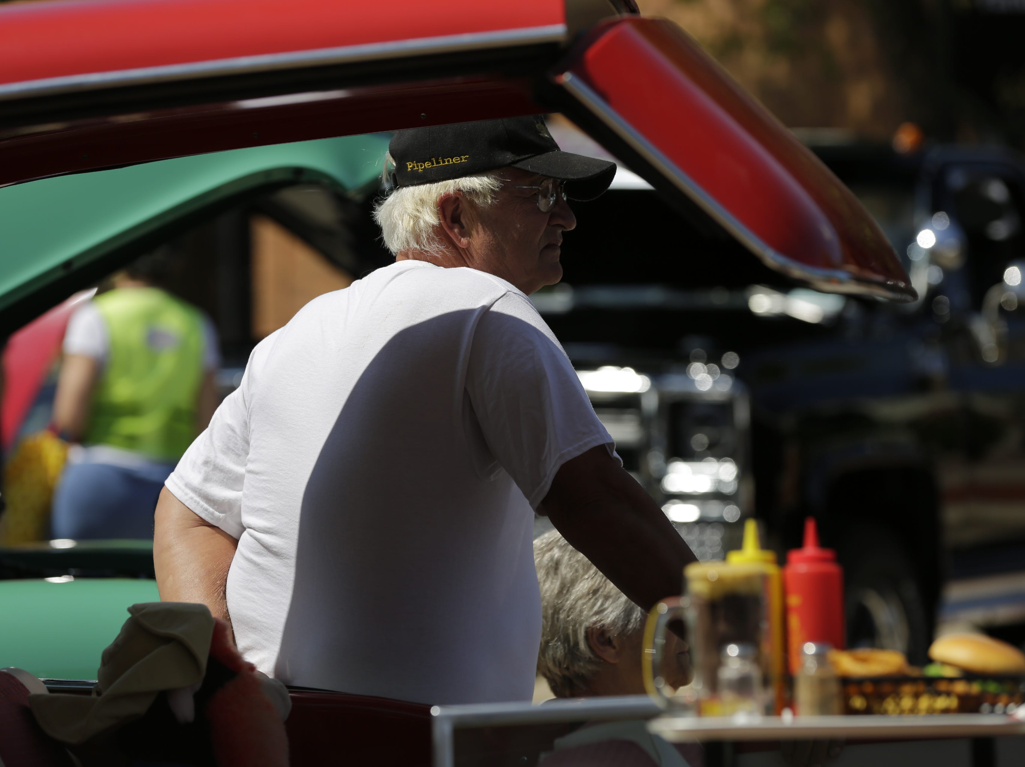 John Christensen from Auburndale leans on his 1957 Ford during the car show at Hub City Days in downtown Marshfield Saturday, July 28, 2018.