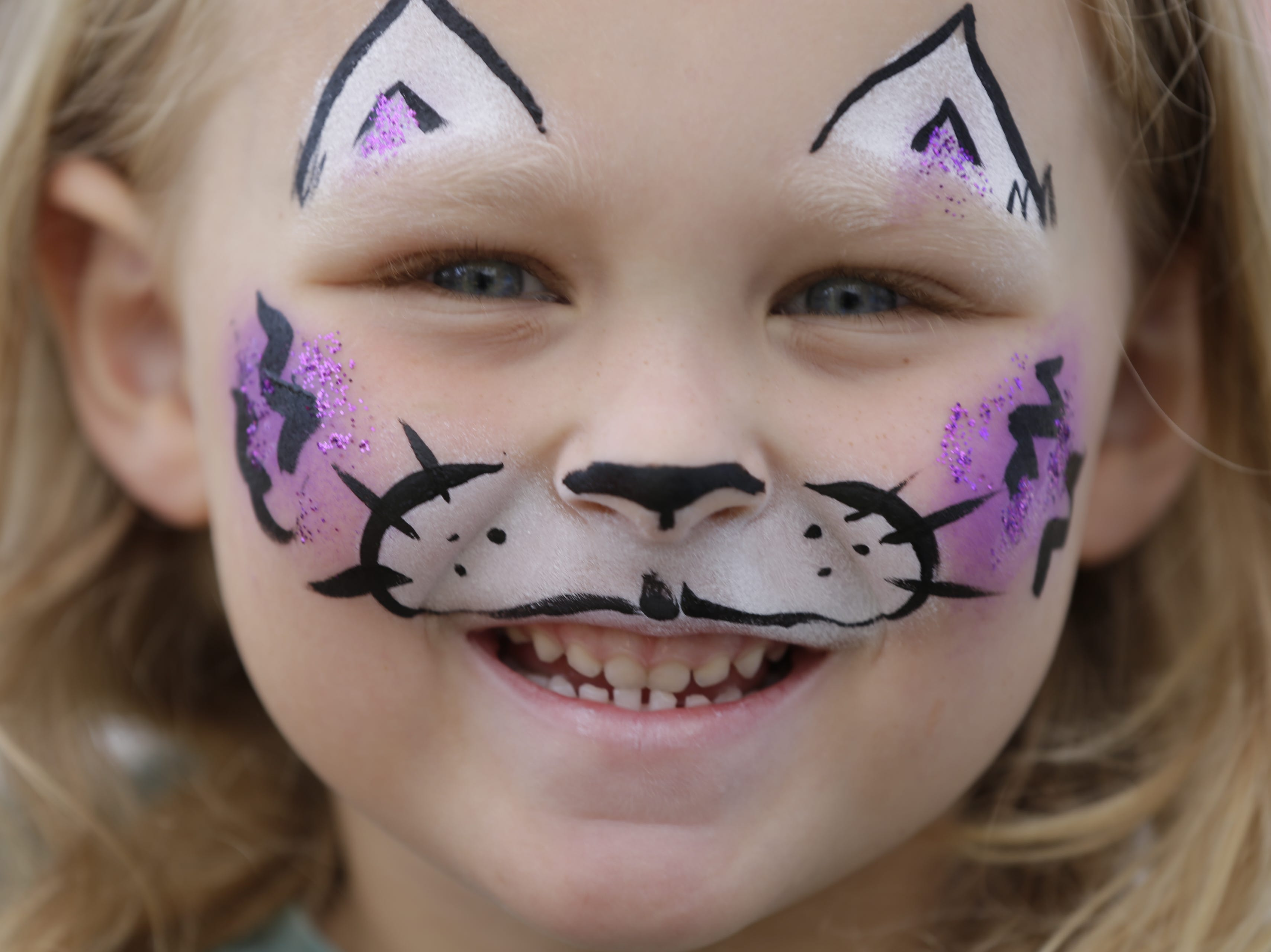 Ellie Kauer, 5, shows off her freshly painted cat face at Hub City Days in downtown Marshfield Saturday, July 28, 2018.