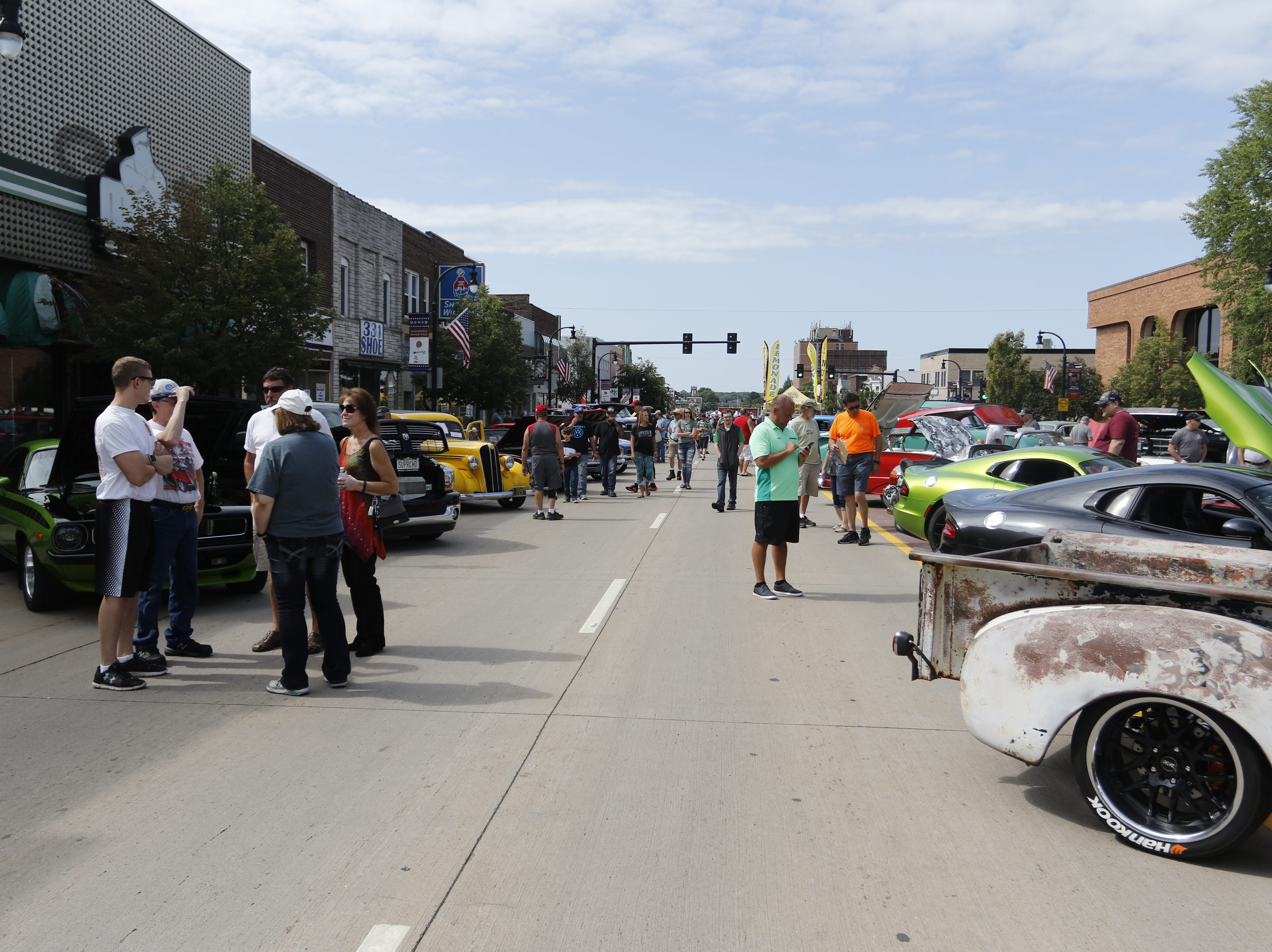 Central Avenue is filled with cars and people during the car show at Hub City Days in downtown Marshfield Saturday, July 28, 2018.