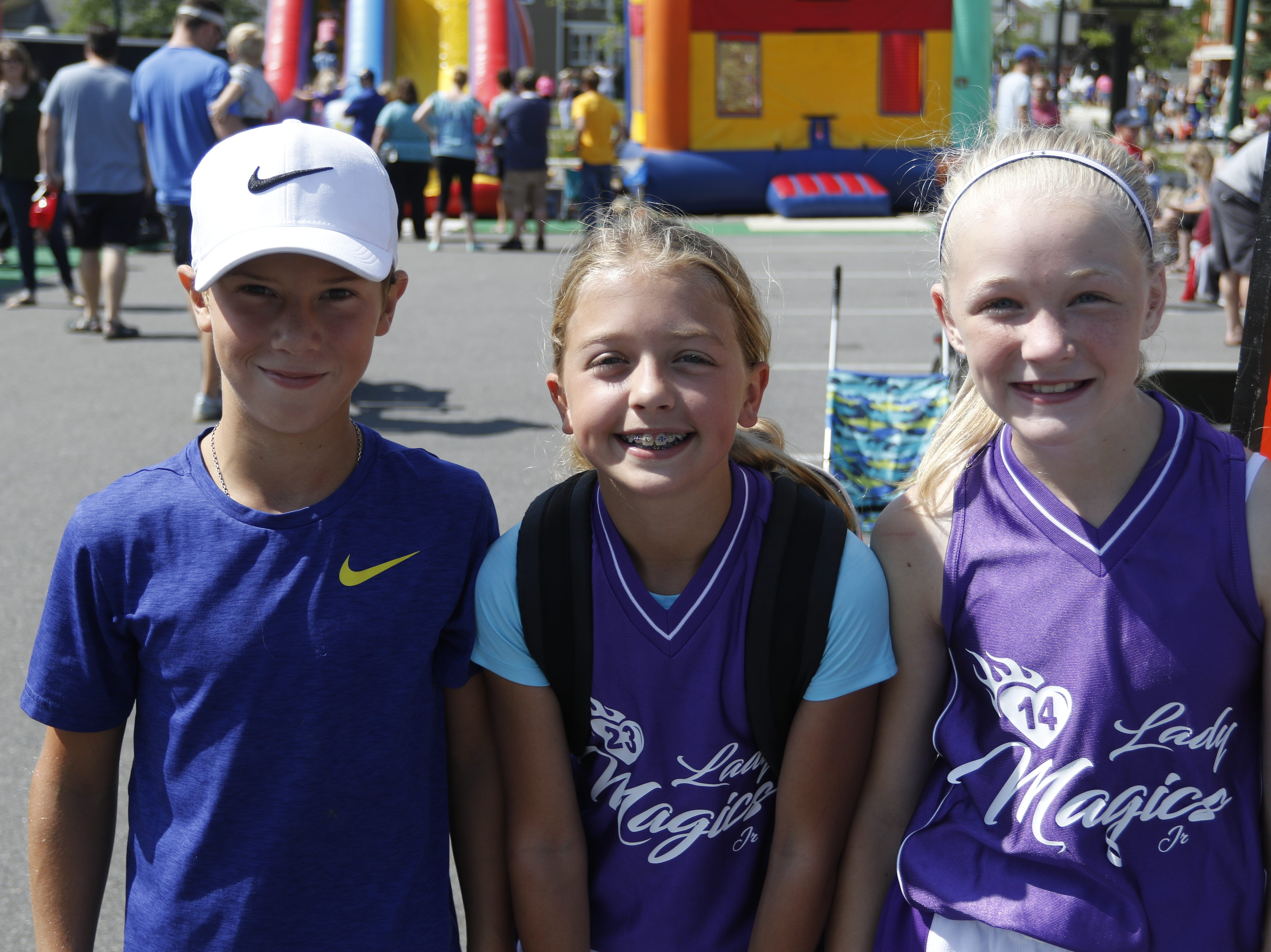Carter Drexler, 11, left, McKenzie Holm, 11 and Delaney Varsho, 11, pose for a photo at Hub City Days in downtown Marshfield Saturday, July 28, 2018.