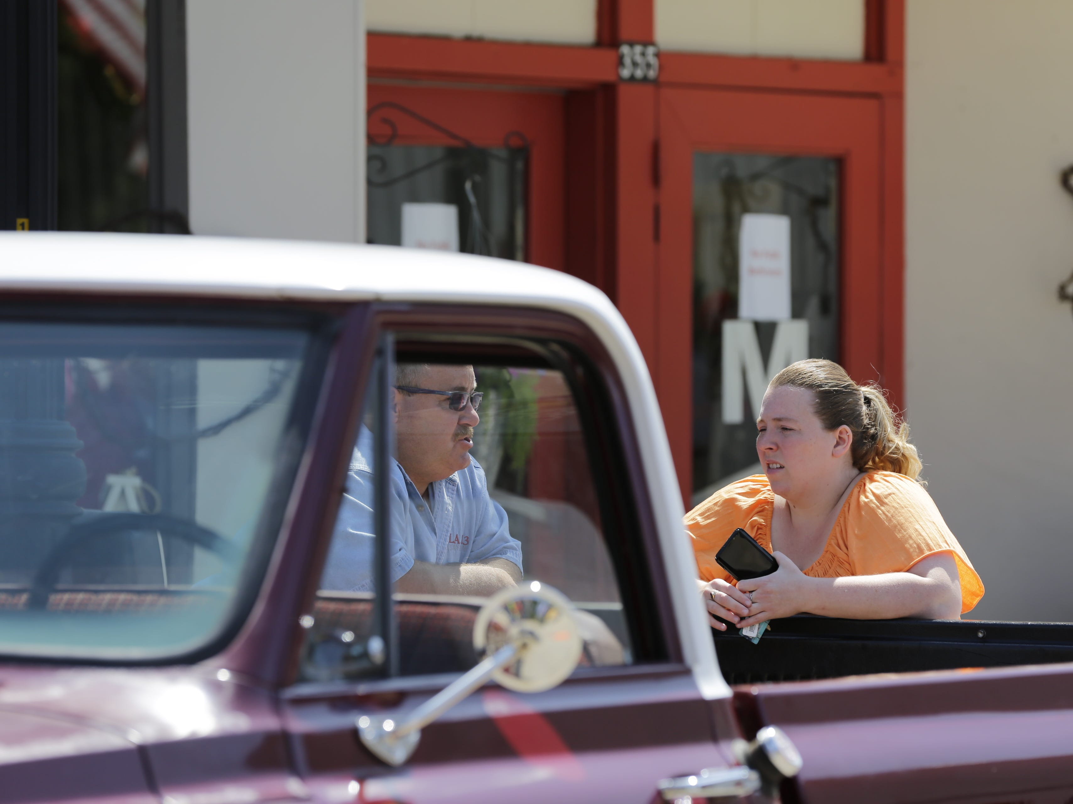 Paul VanDalen leans on his 1968 Chevy C10 truck and talks to his daughter Amy Wallace during the car show on Central Avenue at Hub City Days in downtown Marshfield Saturday, July 28, 2018.