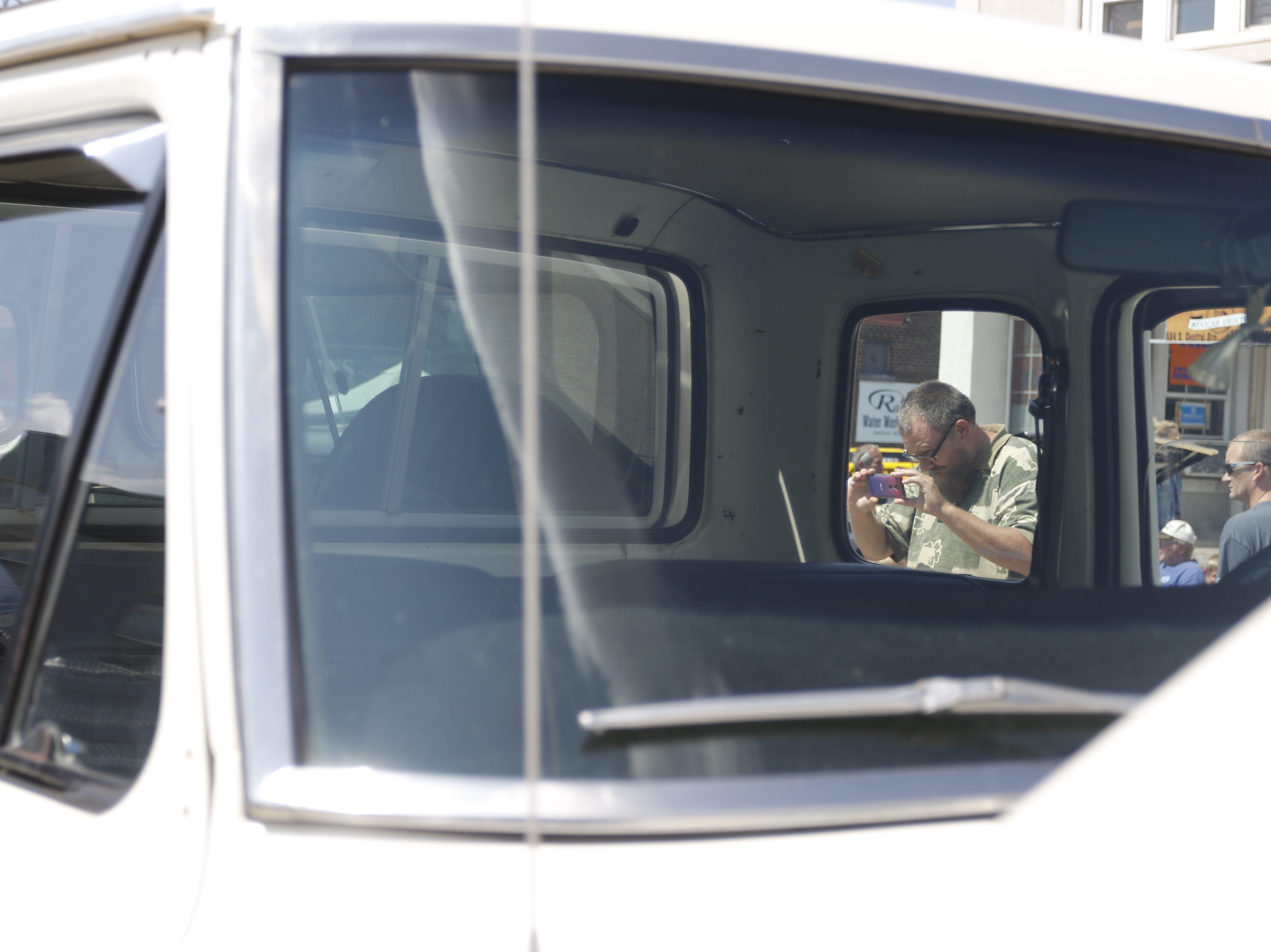 Robert Heise of Fall Creek takes a Snapchat of the rust on a 1976 Ford F250 to show his friends in Tennessee during the car show at Hub City Days in downtown Marshfield Saturday, July 28, 2018.