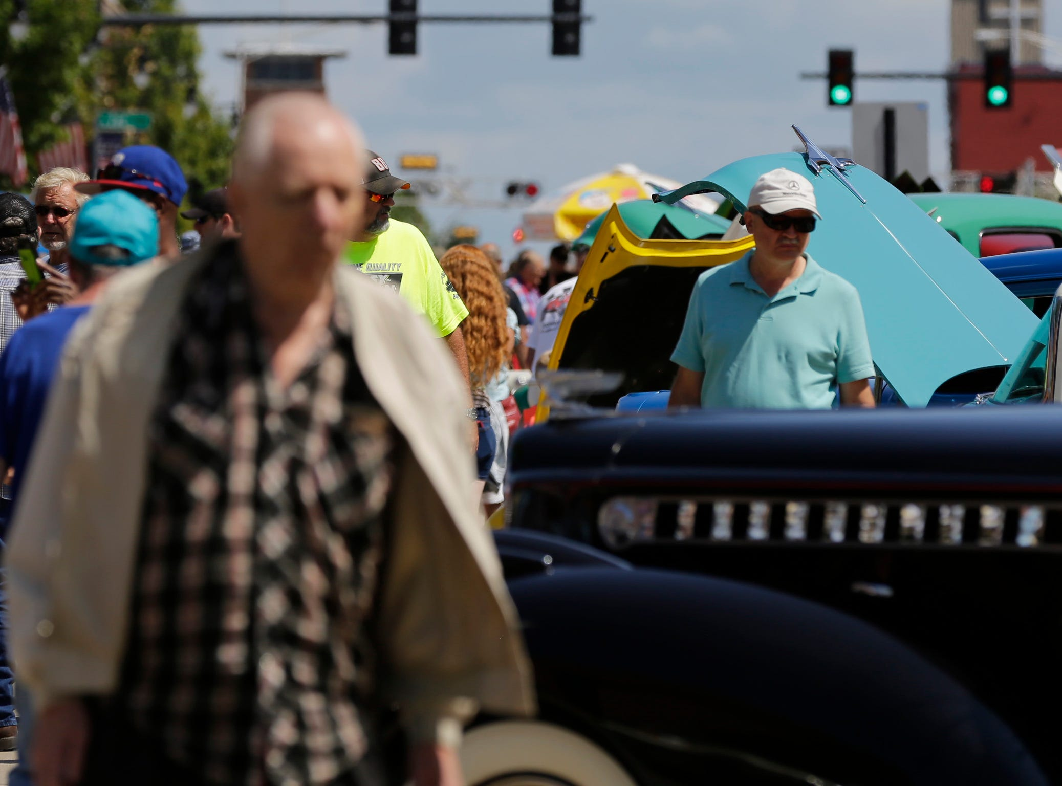 Crowds move through the car show on Central Avenue at Hub City Days in downtown Marshfield Saturday, July 28, 2018.
