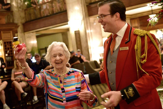 """July 28, 2018 - Minnie Opal Reid Hill displays a rubber duckie presented to her by Peabody Duckmaster Anthony Petrina. Hill celebrated her 100th birthday at The Peabody Hotel by being named honorary """"Duck Master."""" Hill had visited the historic hotel on numerous occasions, but today was the first time she witnessed the famous """"March of the Peabody Ducks."""" Hill also received from the city a declaration stating the day as Minnie Opal Reid Hill Day. """"I am overwhelmed with the attention, this is wonderful,"""" Hill said. """"Once in a lifetime."""""""