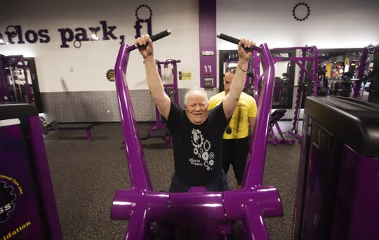 Glenn Sabatka, who has been blind since 1978, works out with trainer Joel Rivera in 2016 at Planet Fitness in San Carlos Park.