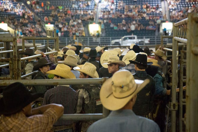 Gathered together for an opening ceremony, 30 competitors participated in the Professional Bull Riders Touring Pro Division at Germain Arena on Friday, July 27, 2018.