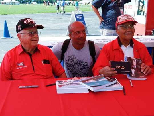 Erich Smith, center, of Peoria, Illinois, poses with Tuskegee Airmen George Hardy and Charles McGee on Saturday, July 28, 2018, during EAA AirVenture 2018 at Wittman Regional Airport in Oshkosh.