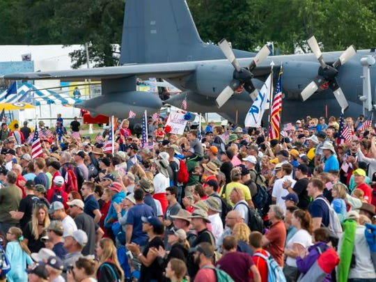 A crowd gathers on the EAA grounds to welcome home Vietnam veterans on a return Old Glory Honor Flight Friday during AirVenture on July 27, 2018.