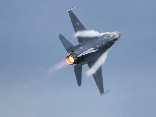 A F16 fighter jet demonstrates its maneuvers during Friday's AirVenture airshow on the EAA grounds July 27, 2018.