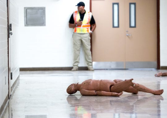 A dummy used for simulation training sprawls in the hallway on July 27, 2018, during an Phoenix Police and Fire Department active shooter training at Carl Hayden High School in Phoenix, Arizona.