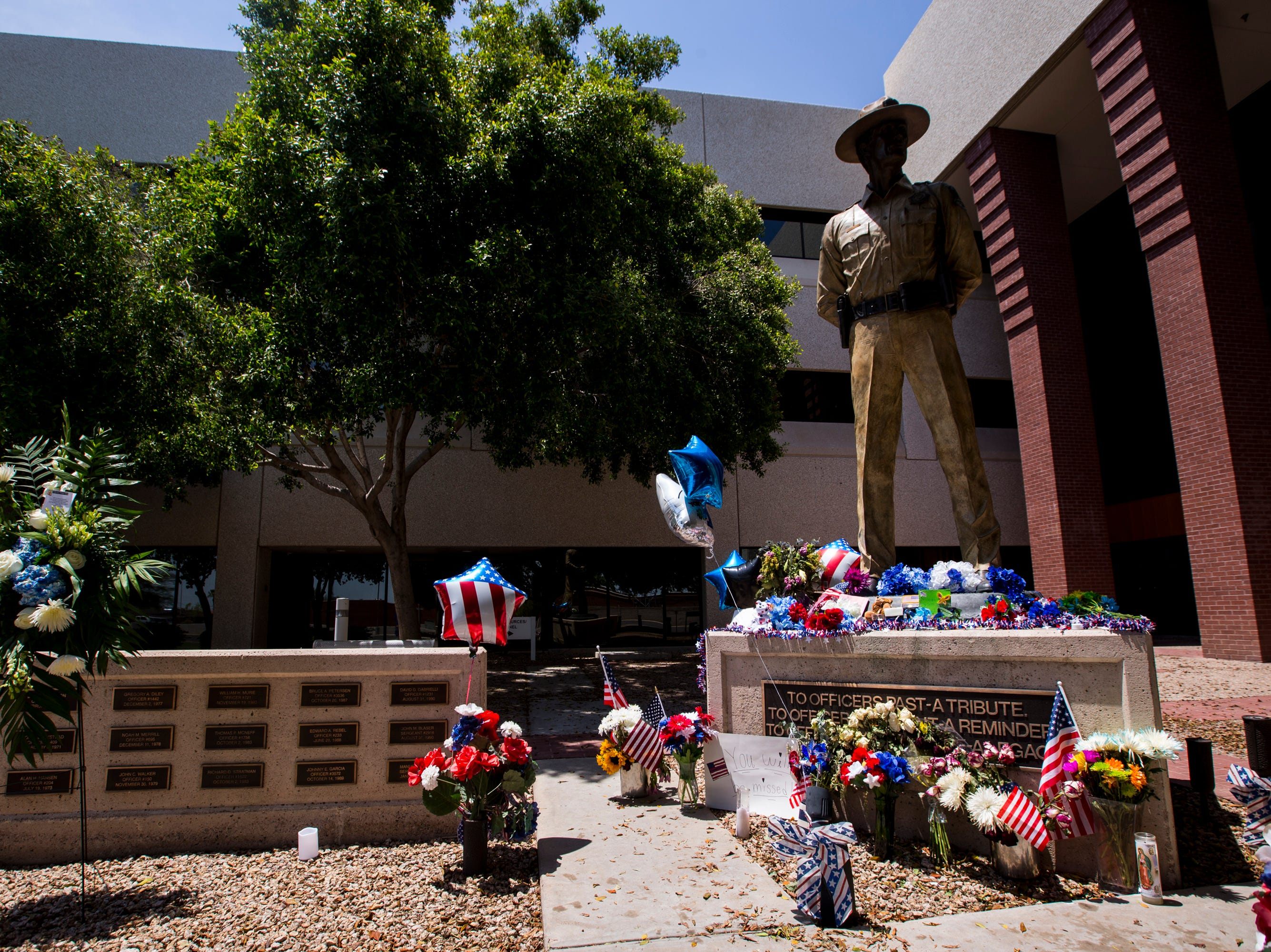 A memorial for DPS Trooper Tyler Edenhofer is pictured on Saturday, July 28, 2018, at the Arizona Department of Public Safety building in Phoenix. Edenhofer was fatally shot on July 25.