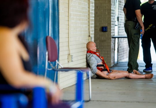 A dummy used for simulation training sits outside a building on July 27, 2018, during an Phoenix Police and Fire Department active shooter training at Carl Hayden High School in Phoenix, Arizona.