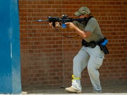 A trainee moves in on a simulated active shooter on July 27, 2018, during an Phoenix Police and Fire Department active shooter training at Carl Hayden High School in Phoenix, Arizona.