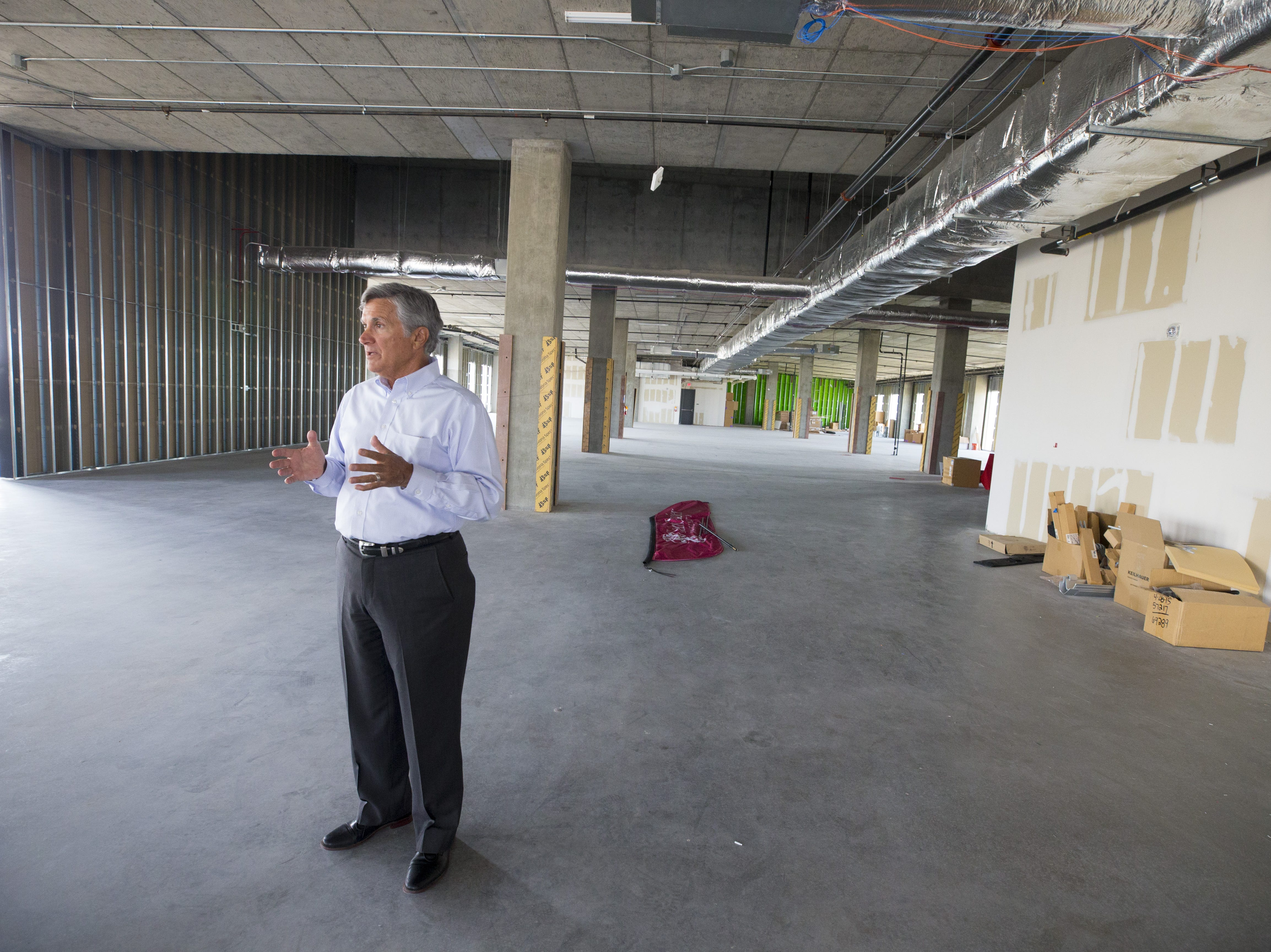 Dr. Jeff Ehrlich, executive director of Park University Gilbert campus tours the Gilbert University Building. The fourth floor of the building is unfinished.