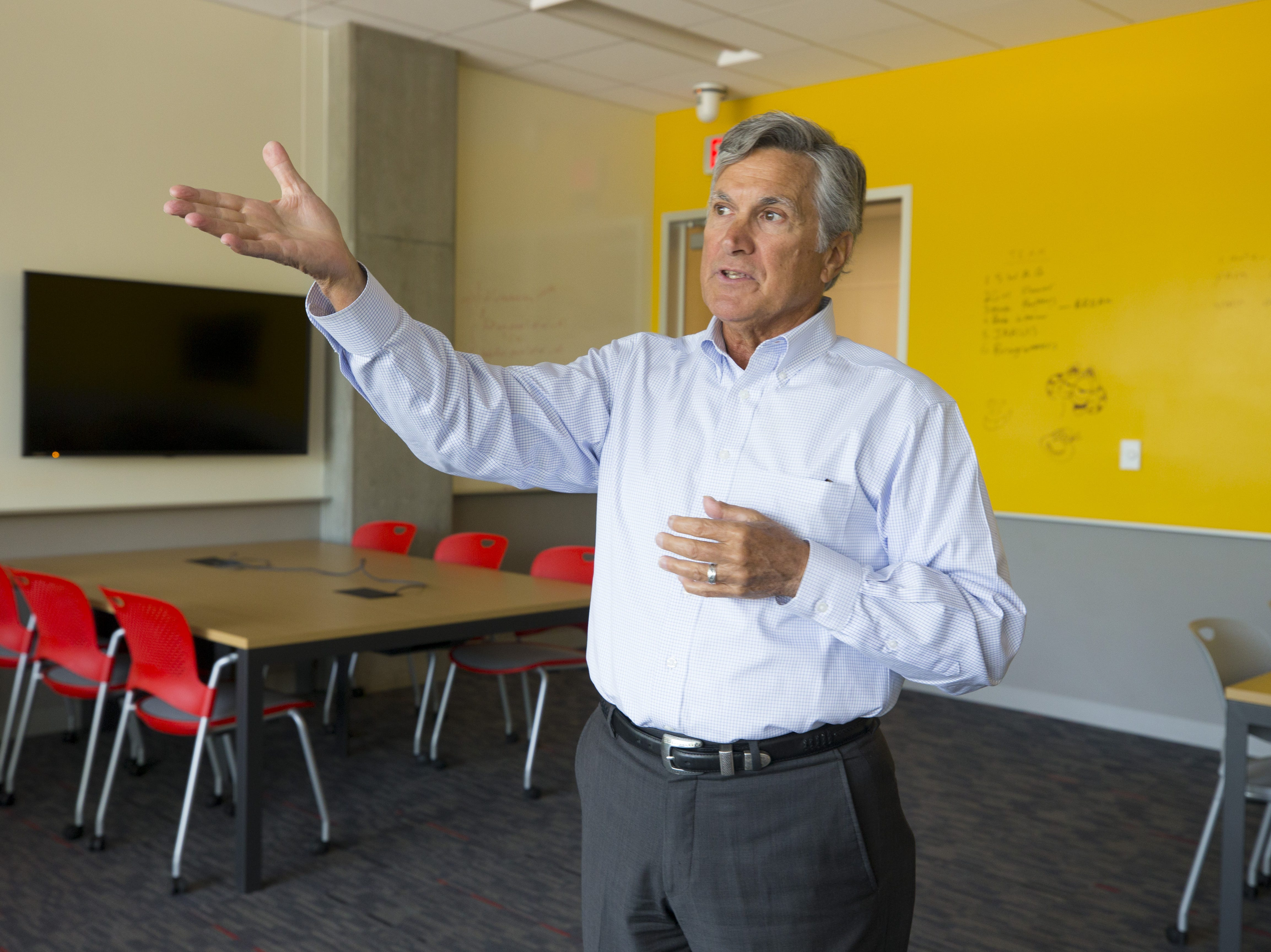Jeff Ehrlich, executive director of Park University Gilbert campus shows off a classroom in the Gilbert University Building.