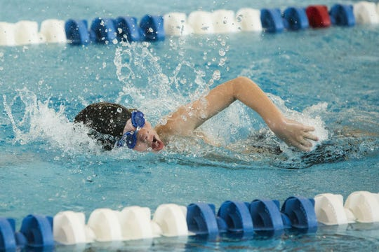 A member of the Bobcat Swim Club competes in the boys 8 and under 100 meter freestyle relay at the 2018 Capital Area Swim League Mid-Cap Championships at Spring Grove Area High School, Saturday, July 28, 2018.