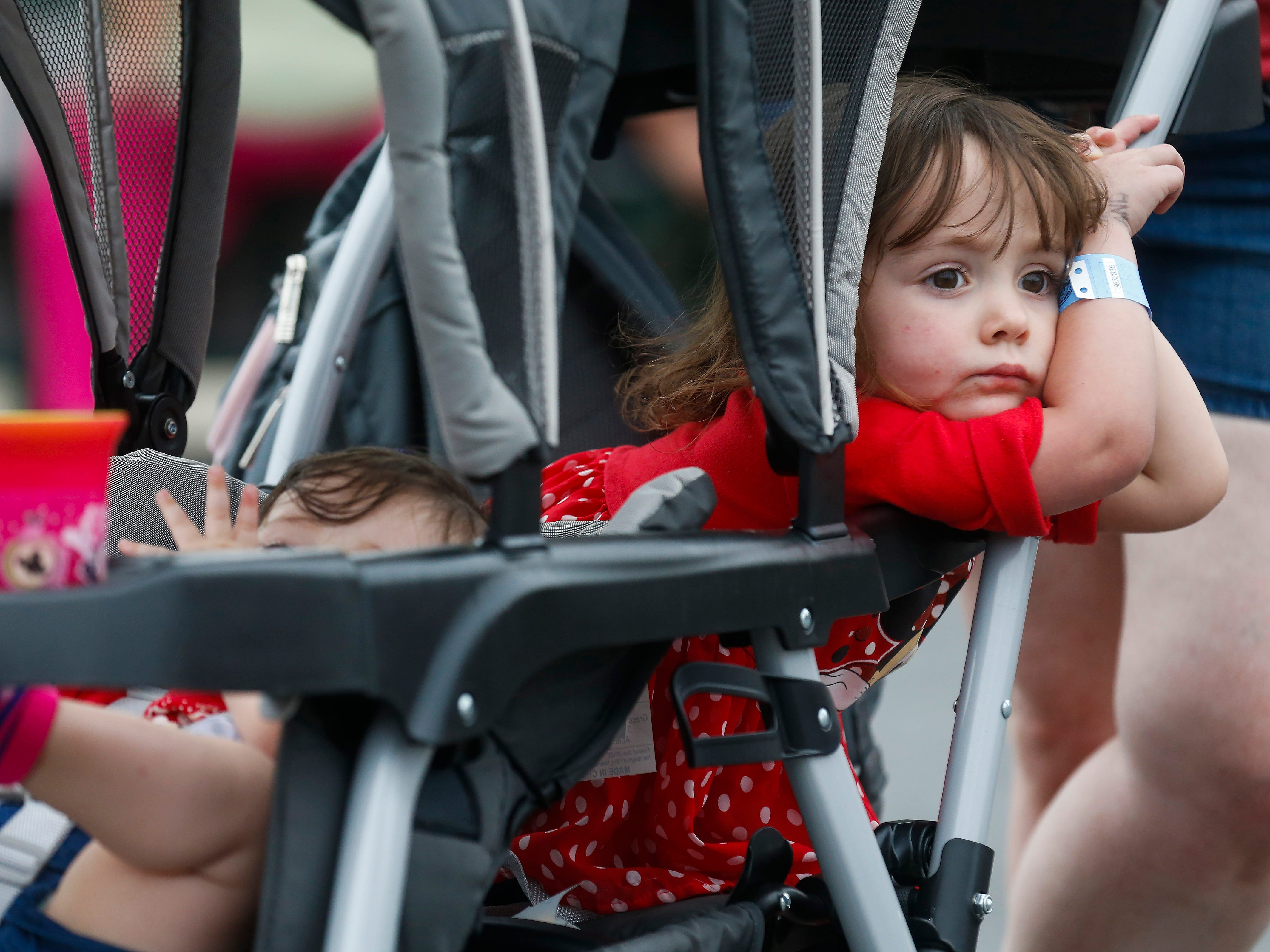 Izebella Gates, 2, of Springfield, looks out the side of her stroller while riding with her sister Annabeth Gates, 7 months, at the Ozark Empire Fair on Saturday, July 28, 2018.