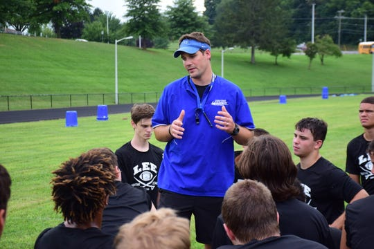 Robert E. Lee head coach Scott Girolmo talks to his players after Leemen held their first football practice of the season on Thursday, July 26, 2018, at Robert E. Lee High School. The Leemen open the season Aug. 24 at Turner Ashby.