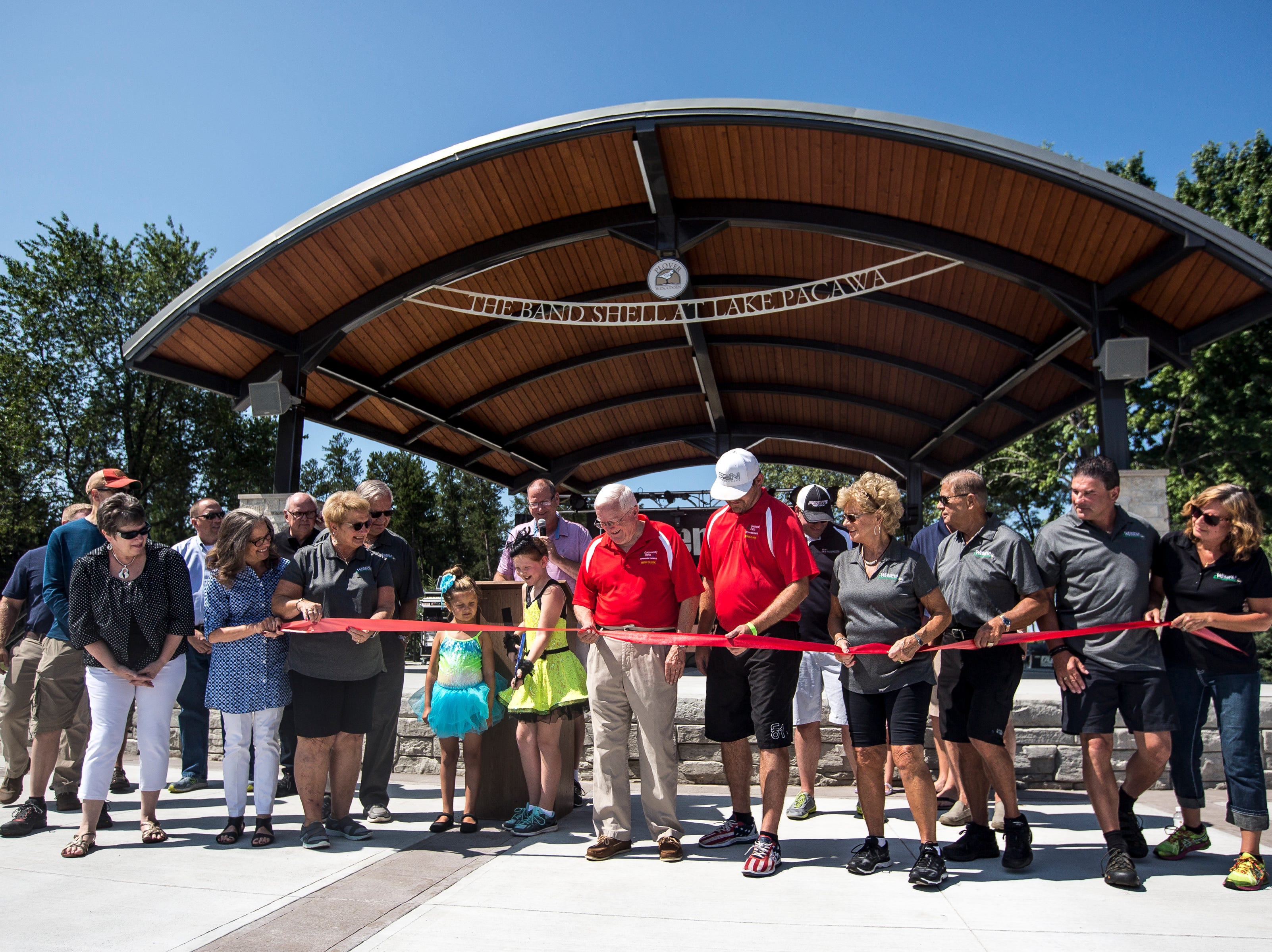 Sponsors prepare to do a ribbon cutting ceremony for the new Band Shell at Lake Pacawa during Celebrate Plover at Lake Pacawa Park in Plover, Wis., July 28, 2018.