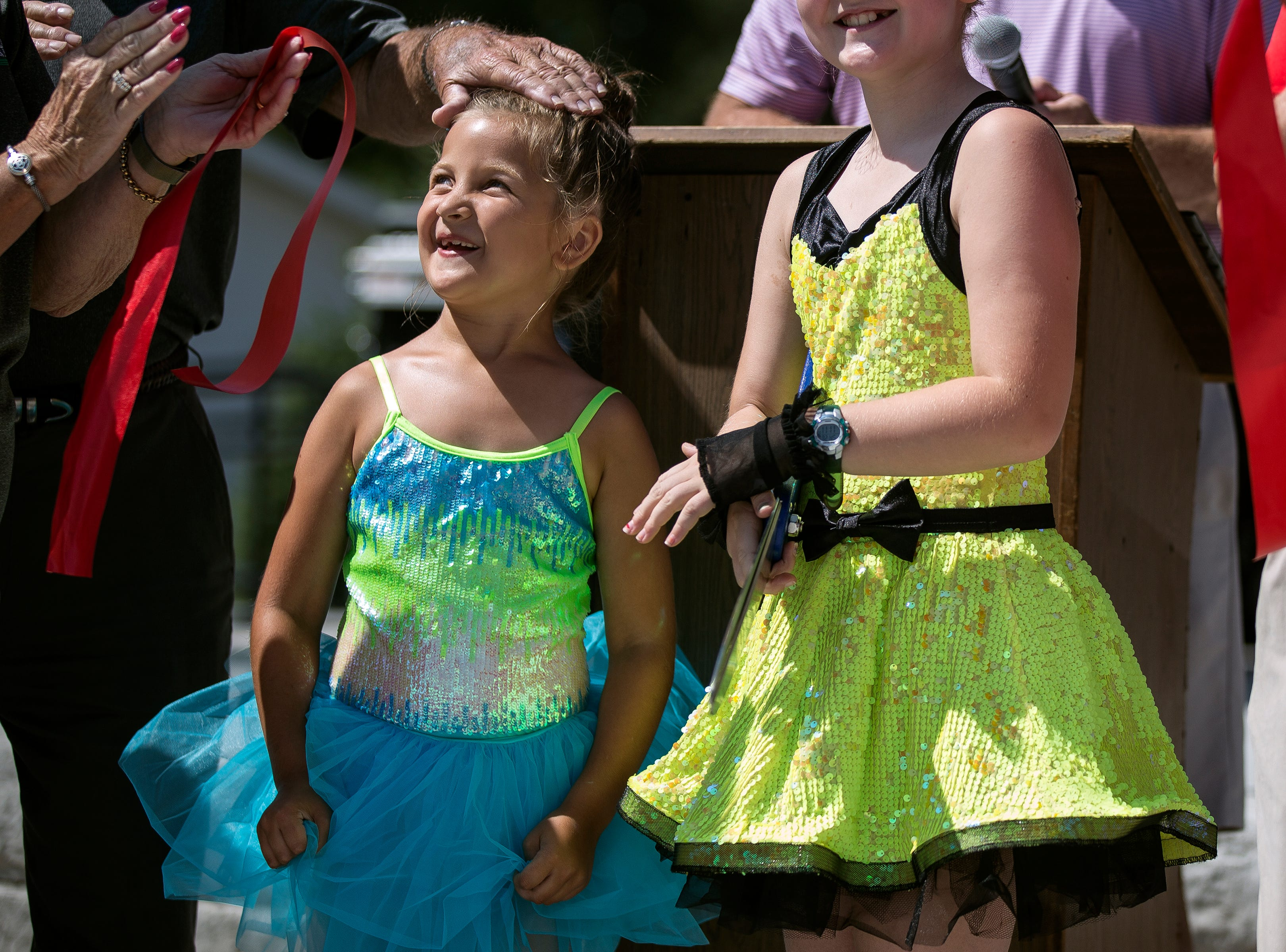 Members of the Dance Dynamics cut the ribbon during a ceremony for the new Band Shell at Lake Pacawa during Celebrate Plover at Lake Pacawa Park in Plover, Wis., July 28, 2018.