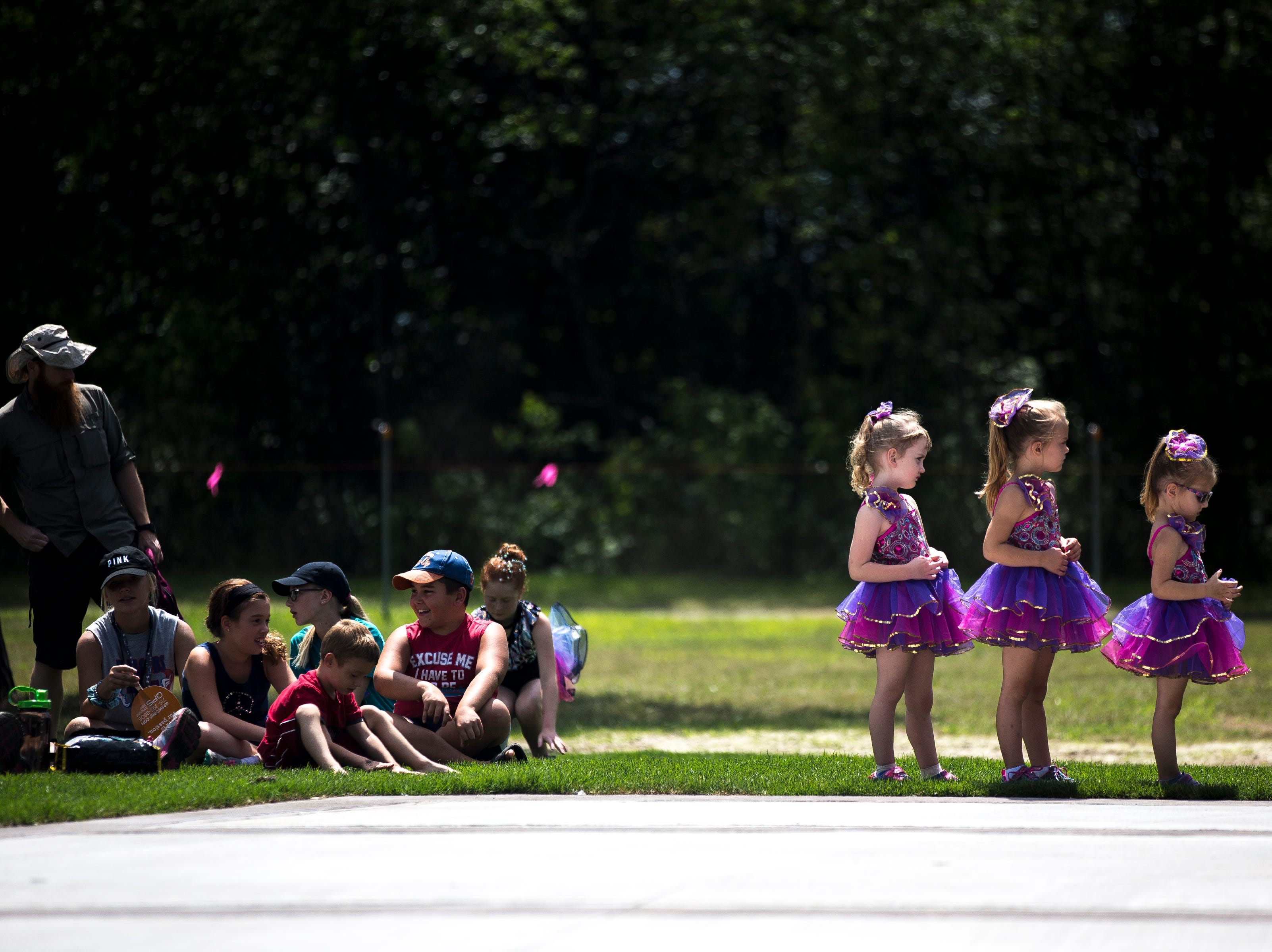 Dancers from Dance Dynamics prepare to take the stage during Celebrate Plover at Lake Pacawa Park in Plover, Wis., July 28, 2018.
