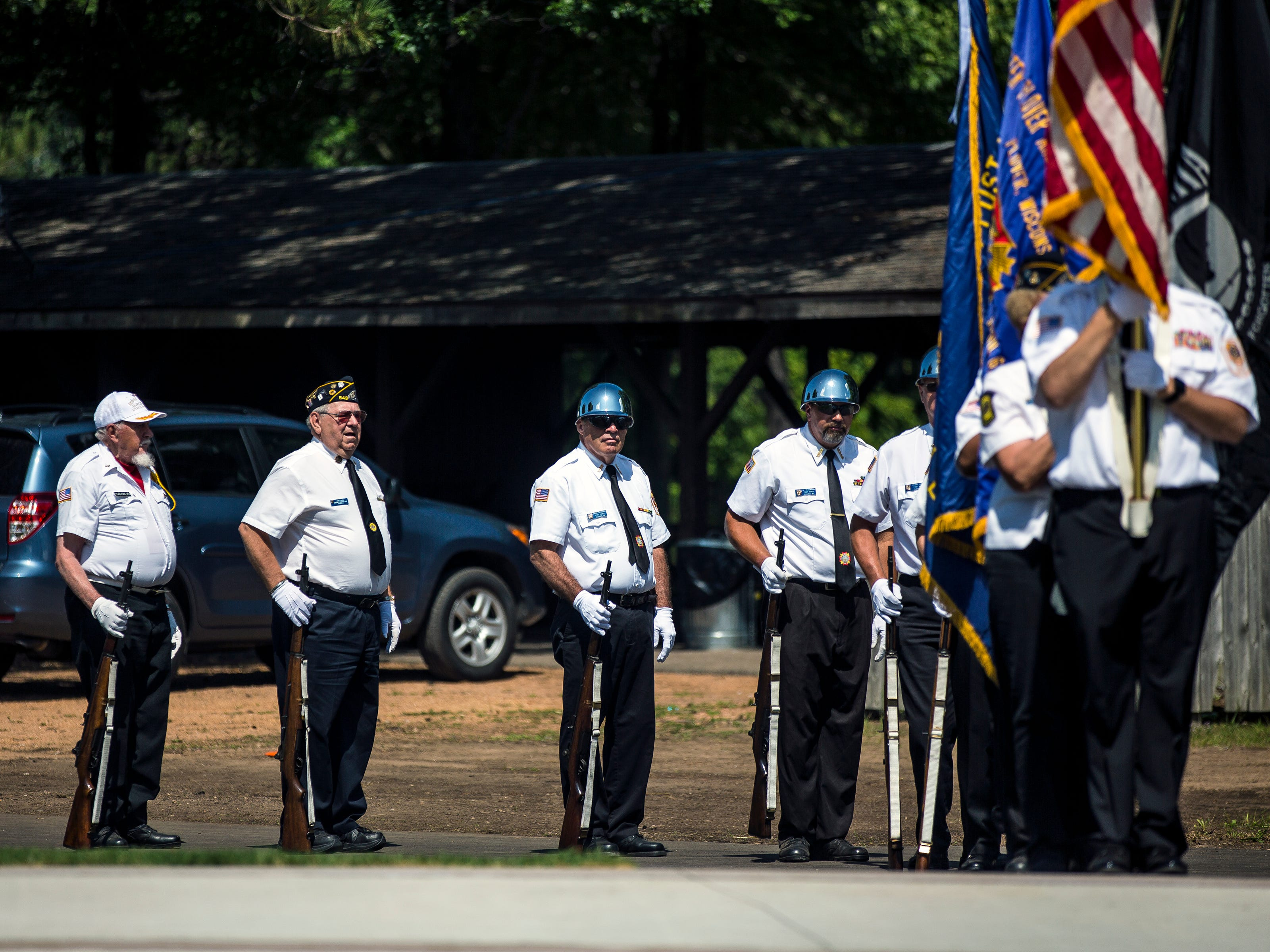 Members of the Plover VFW Post 10262 participate in a ceremony to honor veterans during Celebrate Plover at Lake Pacawa Park in Plover, Wis., July 28, 2018.