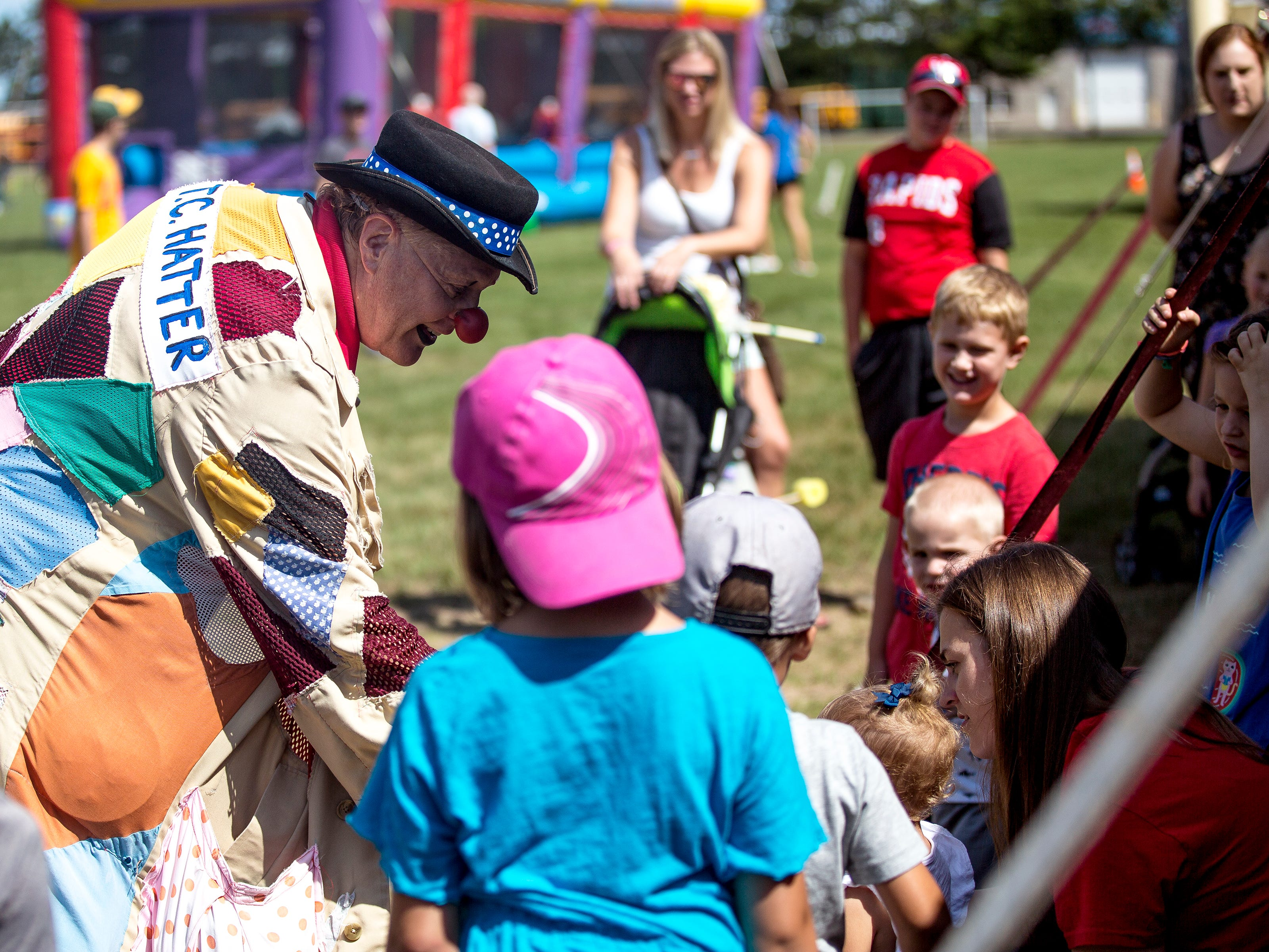 A clown entertains children during Celebrate Plover at Lake Pacawa Park in Plover, Wis., July 28, 2018.