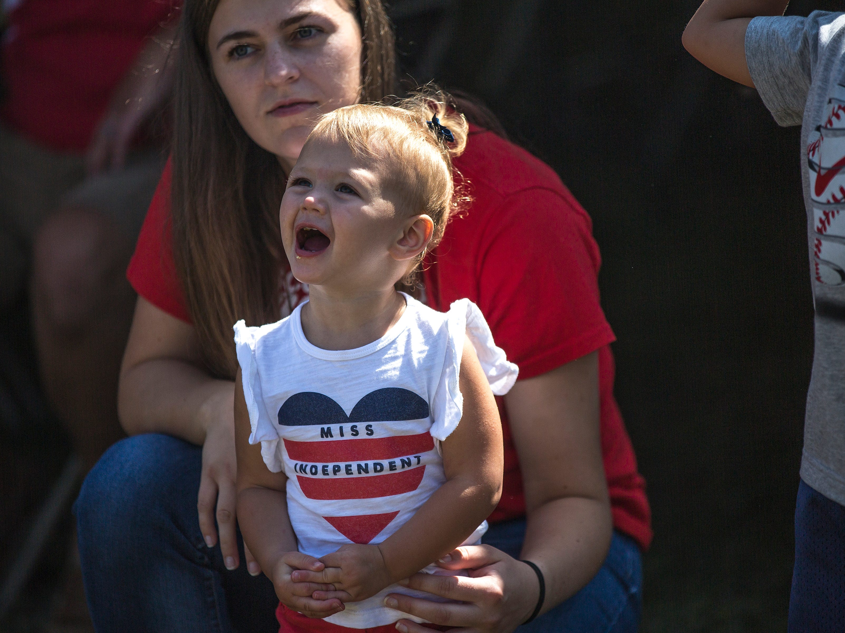 A girl reacts to a helicopter flyover during Celebrate Plover at Lake Pacawa Park in Plover, Wis., July 28, 2018.