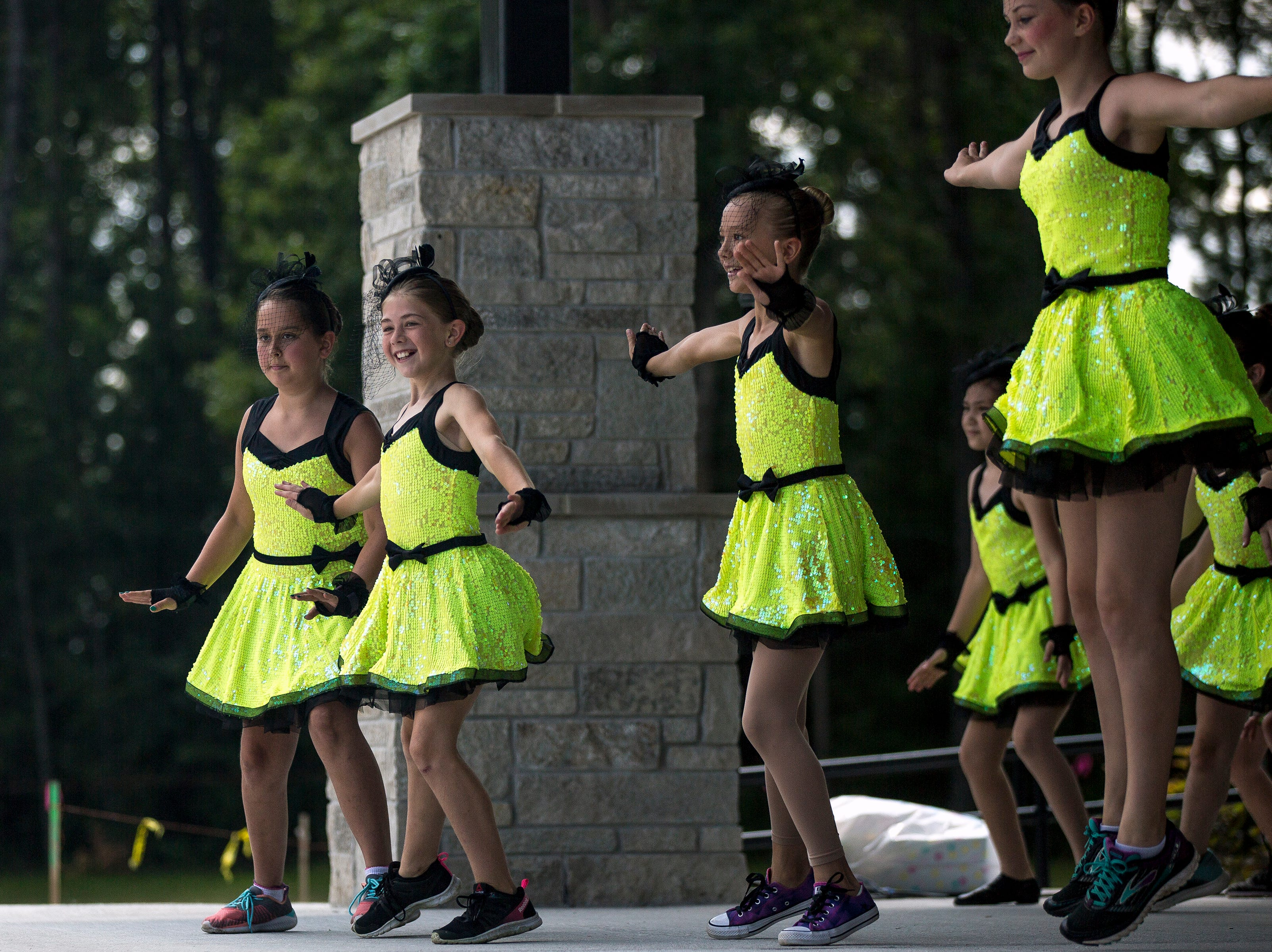Dancers from Dance Dynamics perform during Celebrate Plover at Lake Pacawa Park in Plover, Wis., July 28, 2018.